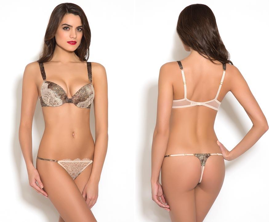 Прозрачный эротический комплект нижнего белья на бесподобной девушке: нежные трусики декорированы стильной вышивкой